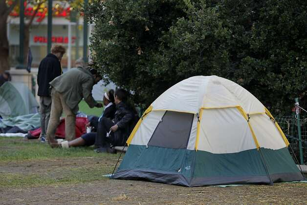 A handful of Occupy Oakland protesters remain at Frank Ogawa Plaza in Oakland, Calif. on Thursday, Oct. 27, 2011. Demonstrators have vowed to reoccupy the park  after a police raid dismantled the encampment before dawn on Tuesday. Photo: Paul Chinn, The Chronicle