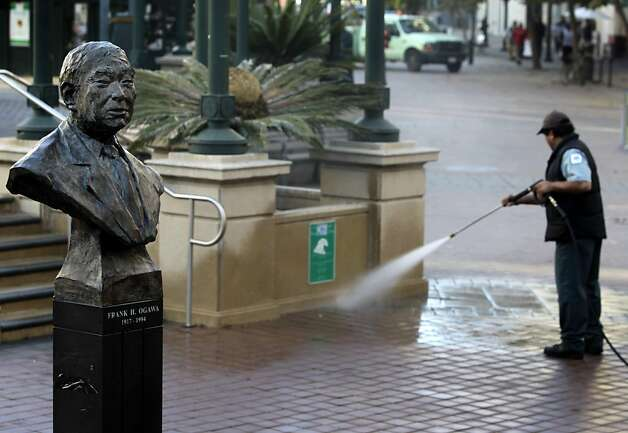 A public works employee uses a power washer to clean Frank Ogawa Plaza in Oakland, Calif. on Thursday, Oct. 27, 2011 after a police raid dismantled the Occupy Oakland encampment before dawn on Tuesday. Demonstrators have vowed to reoccupy the park. Photo: Paul Chinn, The Chronicle