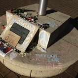 A small shrine remains at Frank Ogawa Plaza in Oakland, Calif. on Thursday, Oct. 27, 2011, for war veteran Scott Olsen, who was injured in Tuesday night's protest of the police raid on the Occupy Oakland encampment. Demonstrators have vowed to reoccupy the park.