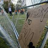 Occupy Oakland protesters tore down a fence blocking entry into Frank Ogawa Plaza and stacked them into triangular structures in Oakland, Calif. on Thursday, Oct. 27, 2011. A police raid dismantled the Occupy Oakland encampment before dawn on Tuesday and demonstrators have vowed to reoccupy the park.