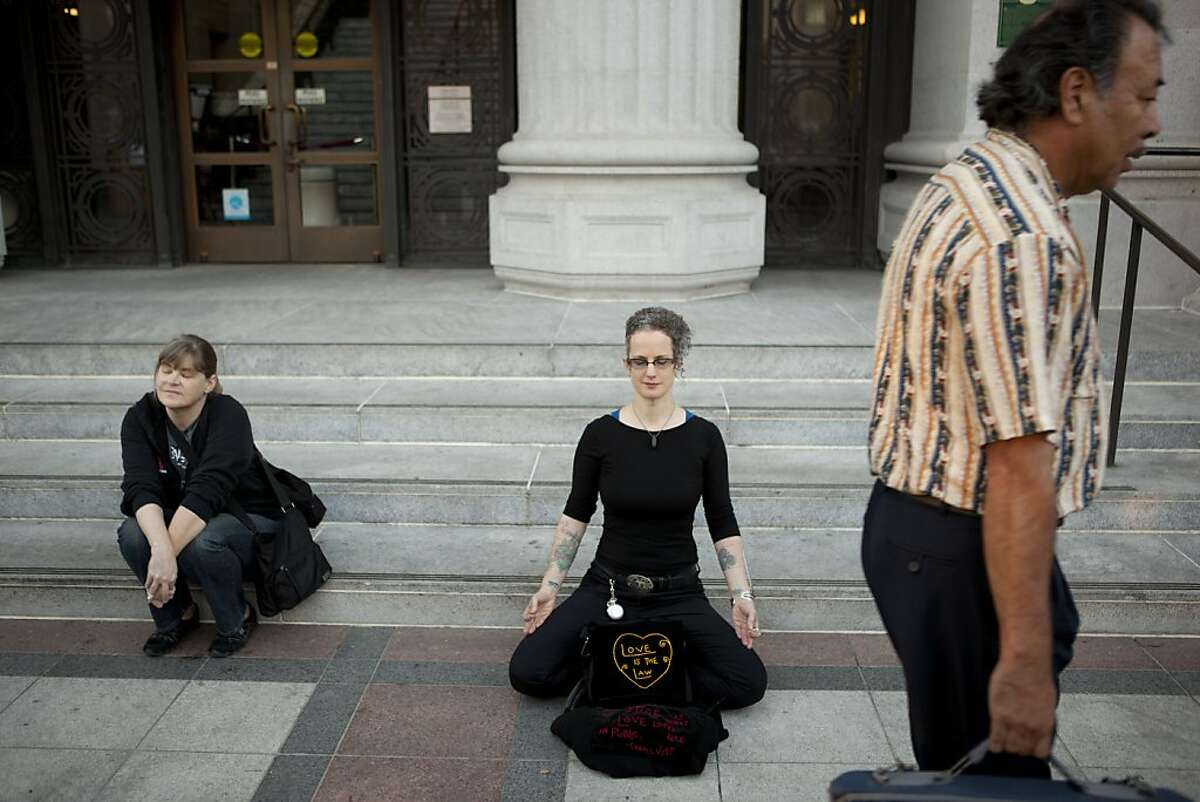 T. Thorn Coyle of Berkeley meditates outside of Oakland City Hall at the Occupy Oakland camp in Frank Ogawa on Thursday, October 27, 2011 in Oakland, Calif.