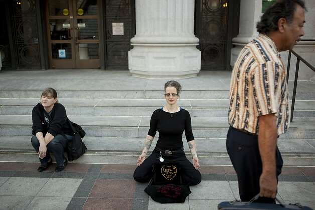 T. Thorn Coyle of Berkeley meditates outside of Oakland City Hall at the Occupy Oakland camp in Frank Ogawa on Thursday, October 27, 2011 in Oakland, Calif. Photo: Beck Diefenbach, Special To The Chronicle