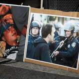 A picture of Scott Olsen, the Iraq War veteran who was injured in Tuesday's protest, stands next to one of Oakland police during a vigil for Olsen outside of Oakland City Hall at the Occupy Oakland camp in Frank Ogawa on Thursday, October 27, 2011 in Oakland, Calif.