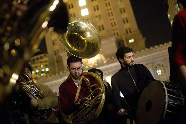 Andrew Cohen (center) and the Inspector Gadje band play play late into the night outside of Oakland City Hall at the Occupy Oakland camp in Frank Ogawa Square on Thursday, October 27, 2011 in Oakland, Calif. Photo: Beck Diefenbach, Special To The Chronicle