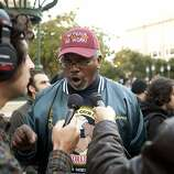 Clarence Thomas, of the International Longshoremen's and Warehousemen's Union speaks with members of the media outside of Oakland City Hall at the Occupy Oakland camp in Frank Ogawa on Thursday, October 27, 2011 in Oakland, Calif.