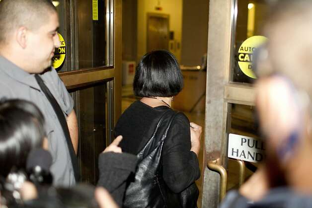 Oakland Mayor Jean Quan enters City Hall after attempting to speak during an open mic session outside of Oakland City Hall at the Occupy Oakland camp in Frank Ogawa Square on Thursday, October 27, 2011 in Oakland, Calif. Photo: Beck Diefenbach, Special To The Chronicle