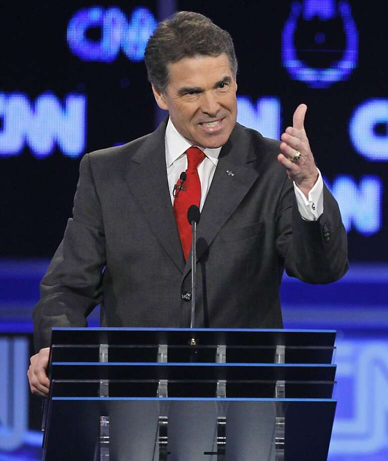 FILE - In this Oct. 18, 2011 file photo, Republican presidential candidate, Texas Gov. Rick Perry gestures during a Republican presidential debate in Las Vegas. Perry won't commit to upcoming GOP presidential debates after a couple of recent rocky performances pulled him down in national polls. Seeking to reintroduce himself to the nation on his own terms, he's returning to the play-it-safe strategy he successfully employed in running for governor of Texas. His decision could cause other Republicans to bow out of some of the dozen-plus forums and debates between now and the Iowa caucuses on Jan. 3. (AP Photo/Chris Carlson, File) Photo: Chris Carlson, AP