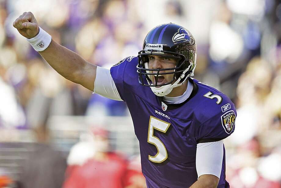 Baltimore Ravens quarterback Joe Flacco celebrates a touchdown during the second half of an NFL football game against the Arizona Cardinals in Baltimore, Sunday, Oct. 30, 2011. (AP Photo/Patrick Semansky)  Ran on: 10-31-2011 Photo caption Dummy text goes here. Dummy text goes here. Dummy text goes here. Dummy text goes here. Dummy text goes here. Dummy text goes here. Dummy text goes here. Dummy text goes here.###Photo: rail31_PH1319846400AP###Live Caption:Baltimore Ravens quarterback Joe Flacco celebrates a touchdown during the second half of an NFL football game against the Arizona Cardinals in Baltimore, Sunday, Oct. 30, 2011.###Caption History:Baltimore Ravens quarterback Joe Flacco celebrates a touchdown during the second half of an NFL football game against the Arizona Cardinals in Baltimore, Sunday, Oct. 30, 2011. (AP Photo-Patrick Semansky)###Notes:Joe Flacco###Special Instructions: Photo: Patrick Semansky, AP