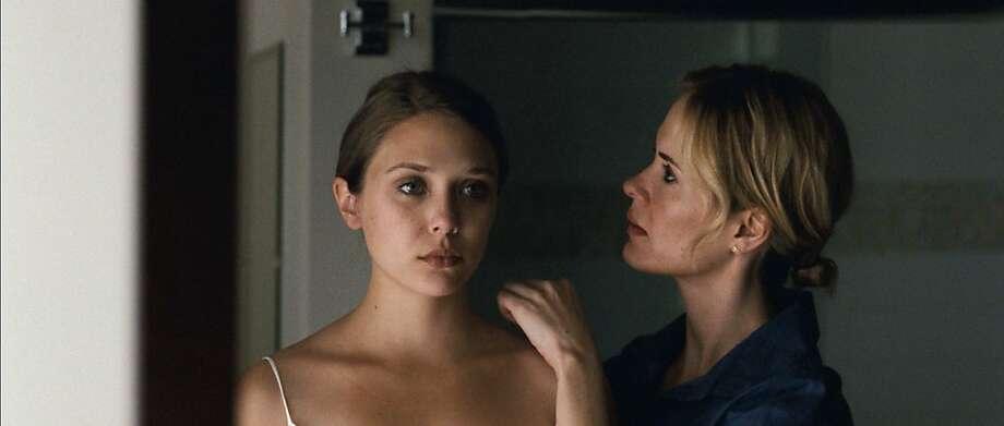 Elizabeth Olsen and Sarah Paulson in MARTHA MARCY MAY MARLENE Photo: Jody Lee Lipes, Twentieth Century Fox