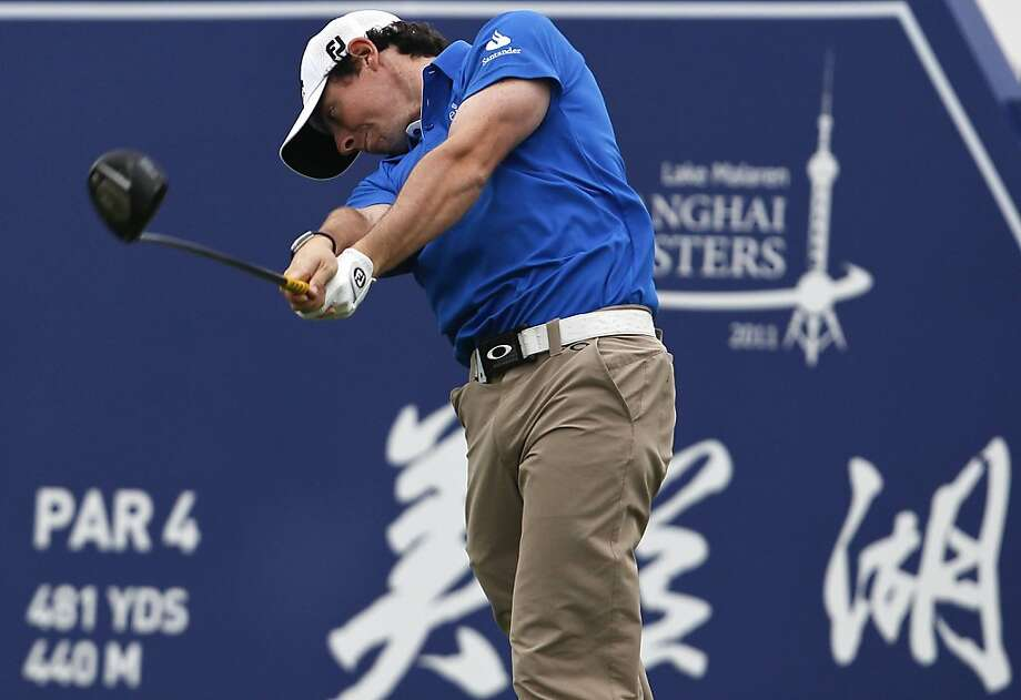 Rory McIlroy of Northern Ireland tees off on the 9th hole during the third round of the Lake Malaren Shanghai Masters golf tournament in Shanghai, China, Saturday, Oct. 29, 2011. (AP Photo/Alexander F. Yuan)  Ran on: 10-30-2011 Rory McIlroy tees off on the ninth hole at the Lake Malaren Shanghai Masters. He had seven birdies in the third round. Ran on: 10-30-2011 Rory McIlroy tees off on the ninth hole at the Lake Malaren Shanghai Masters. He had seven birdies in the third round. Photo: Alexander F. Yuan, AP