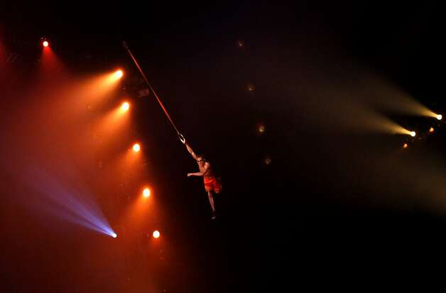 A rings performer swings from the big top during Cirque du Soleil's production of Totem at the Grand Chapiteau tent at AT&T Park in San Francisco, Calif., Thursday, October 27, 2011. Photo: Sarah Rice, Special To The Chronicle