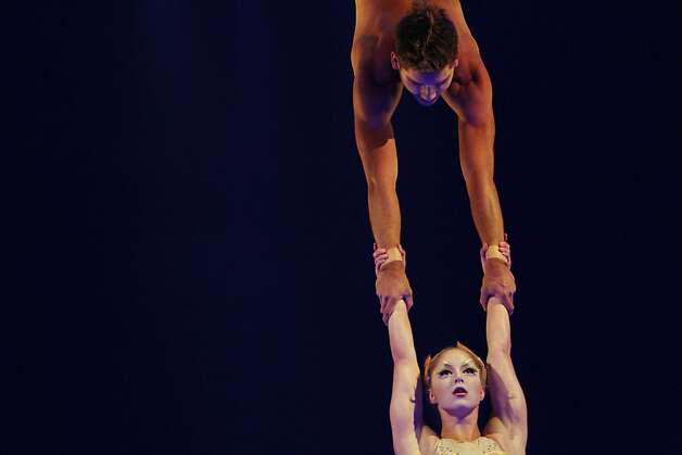 Rosalie Ducharme and Louis-David Simoneau perform on the fixed trapeze during Cirque du Soleil's production of Totem at the Grand Chapiteau tent at AT&T Park in San Francisco, Calif., Thursday, October 27, 2011. Photo: Sarah Rice, Special To The Chronicle