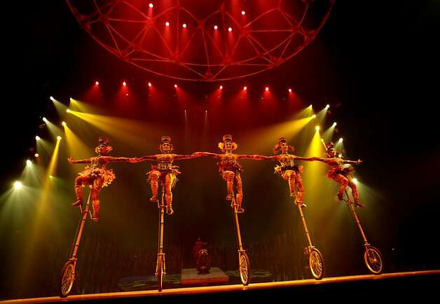 Performers on unicycles balancing bowls on their heads line up during Cirque du Soleil's production of Totem at the Grand Chapiteau tent at AT&T Park in San Francisco, Calif., Thursday, October 27, 2011. Photo: Sarah Rice, Special To The Chronicle
