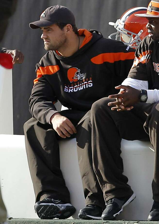 Cleveland Browns' running back Peyton Hillis sits on the bench in street close as his team faces the Seattle Seahawks in an NFL football game on Sunday, Oct. 23, 2011, in Cleveland. Hillis did not play in the game.   (AP Photo/Amy Sancetta)  Ran on: 10-28-2011 Injuries have rendered Peyton Hillis largely ineffective this season after a breakout 2010. Ran on: 10-28-2011 Injuries have rendered Peyton Hillis largely ineffective this season after a breakout 2010. Photo: Amy Sancetta, AP