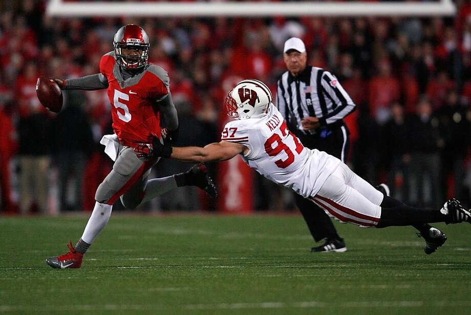 COLUMBUS, OH - OCTOBER 29:  Braxton Miller #5 of the Ohio State Buckeyes breaks a tackle by Brendan Kelly #97 of the Wisconsin Badgers during the fourth quarter on October 29, 2011 at Ohio Stadium in Columbus, Ohio. Ohio State defeated Wisconsin 33-29.(Photo by Kirk Irwin/Getty Images) Photo: Kirk Irwin, Getty Images