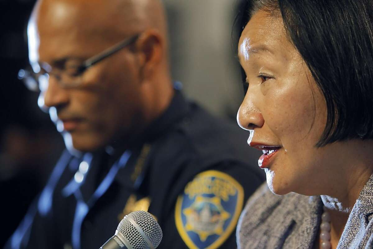 Oakland Mayor Jean Quan, right, answers a question during a press conference at City Hall in Oakland, Calif, on Wednesday, October 26, 2011. Quan, interim Police Chief Howard Jordan, left, and City Administrator Deanna Santana, off camera, anwered questions, Wednesday, after police used tear gas and non-lethal weapons against demonstrators from the Occupy Oakland group the previous night.