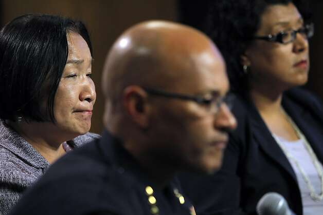Oakland Mayor Jean Quan, left, listens to a question during a press conference at City Hall in Oakland, Calif, on Wednesday, October 26, 2011. Quan, interim Police Chief Howard Jordan, and City Administrator Deanna Santana anwered questions, Tuesday, after police used tear gas and non-lethal weapons against demonstrators from the Occupy Oakland group the previous night. Photo: Carlos Avila Gonzalez, The Chronicle