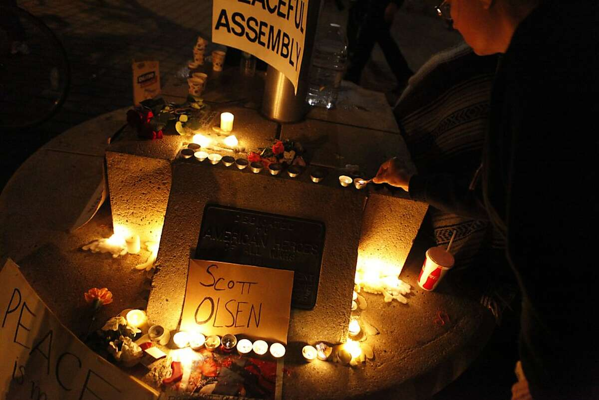 A shrine for Scott Olsen, critically wounded by a less-than-lethal projectile during a protest, at Frank Ogawa Plaza in front of City Hall in Oakland, Calif., on Wednesday, Oct. 27, 2011.