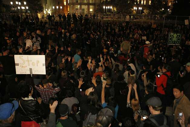 Occupy Oakland protestors raise their hands in agreement with a fellow protestor making a speech, at Frank Ogawa Plaza in Oakland, Calif., on Wednesday, Oct. 27, 2011. Photo: Dylan Entelis, The Chronicle