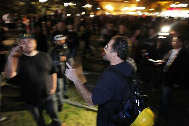 Two Occupy Oakland protesters argue whether to remove chain link fence from where the group's camp had previously been located in Frank Ogawa Plaza. Occupy Oakland protesters returned to Frank Ogawa Plaza in Oakland, Calif, on Wednesday, October 26, 2011. . Photo: Carlos Avila Gonzalez, The Chronicle