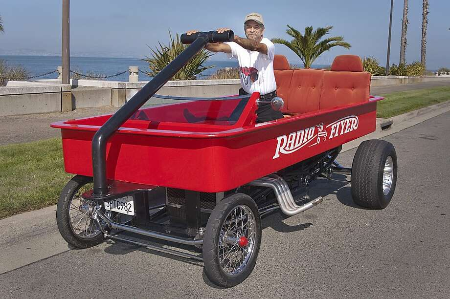 photos of robert castaneda and his custommade red radio flyer motor vehicle on a