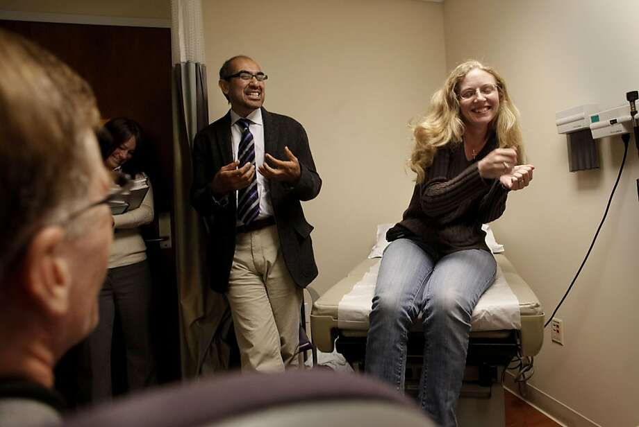 (left to right) Dr. Alain Algazi, Andrea Kantor, clinical trial coordinator and Dr. Adil Daud, program director of the UCSF Melanoma program, deliver good news to, patient Shannon Jimerson, at UCSF Medical center in San Francisco, Ca., on Wednesday October 26, 2011, that  recent CT/PET scans have shown promising results in her cancer treatments.  Shannon Jimerson, has been a participant in a new clinical trial to treat her late-stage Melanoma. So far she and her doctors have seen dramatic results with the new treatments with a continued reduction in the size of her cancerous tumors. Photo: Michael Macor, The Chronicle