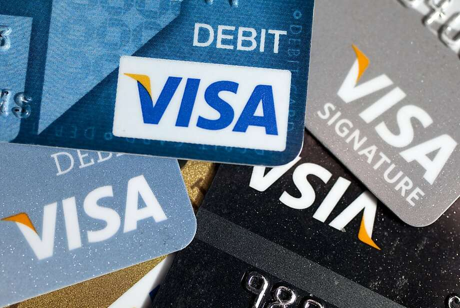 Visa Inc. credit and debit cards are arranged for a photograph in Washington, D.C., U.S., on Monday, Oct. 24, 2011. Visa Inc. is expected to release third-quarter earnings on Oct. 26. Photographer: Andrew Harrer/Bloomberg Photo: Andrew Harrer, Bloomberg