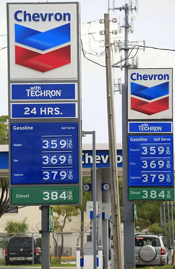 In this Oct. 27, 2011 photo, the signs for two Chevron gas stations across the street from each other are displayed in Miami Lakes, Fla. Chevron Corp.'s quarterly profit more than doubled as a jump in oil prices made up for declining production. (AP Photo/Wilfredo Lee)  Ran on: 10-29-2011 Higher gas prices helped boost Chevron's bottom line, along with strong crude sales.   Ran on: 12-07-2011 Chevron is considering a $40 million investment to produce 5 billion barrels of oil. Photo: Wilfredo Lee, AP