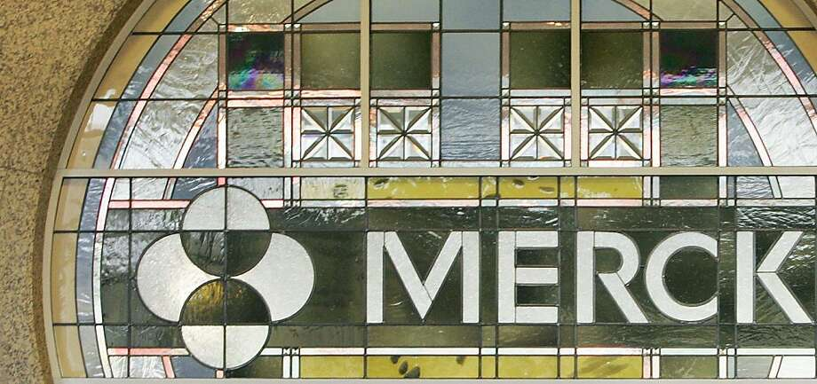 FILE - In this file photo made April 15, 2009, the Merck logo is seen in the lobby of Merck & Company, Inc.'s world headquarters in Whitehouse Station, N.J. Drugmaker Merck & Co. quadrupled its third-quarter profit Friday, Oct. 28, 2011, compared with a year-ago quarter weighed down by huge acquisition and legal charges. (AP Photo/Mel Evans, File)  Ran on: 10-29-2011 Merck & Co. report's third-quarter profit rose compared with its third quarter a year ago. Photo: Mel Evans, AP