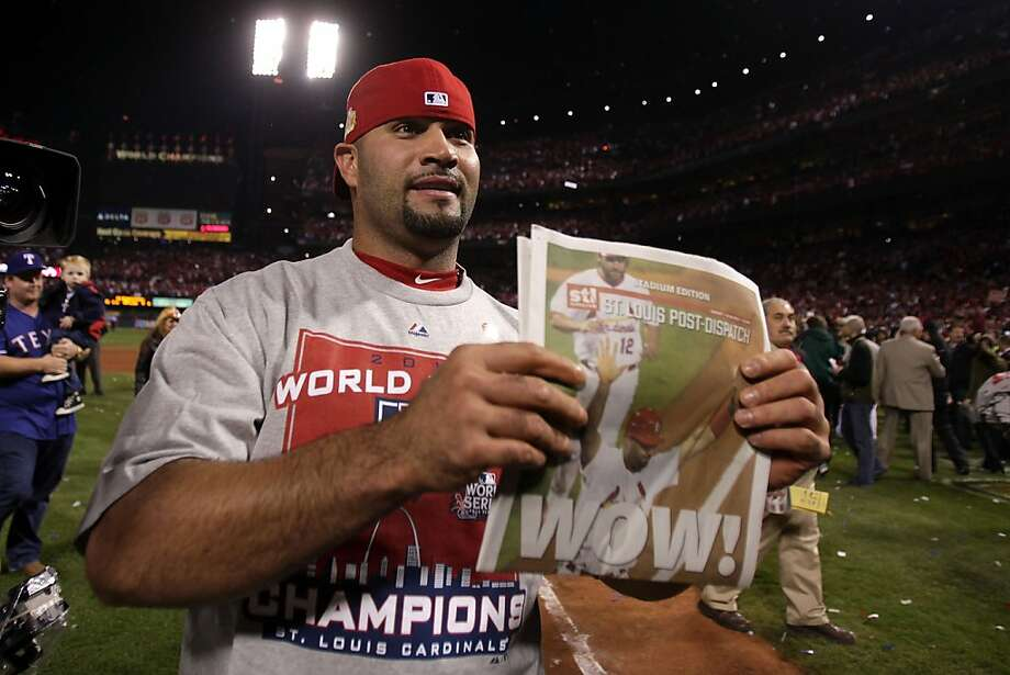 ST LOUIS, MO - OCTOBER 28:  Albert Pujols #5 of the St. Louis Cardinals celebrates after defeating the Texas Rangers 6-2 to win the World Series in Game Seven of the MLB World Series at Busch Stadium on October 28, 2011 in St Louis, Missouri.  (Photo by Ezra Shaw/Getty Images) Photo: Ezra Shaw, Getty Images