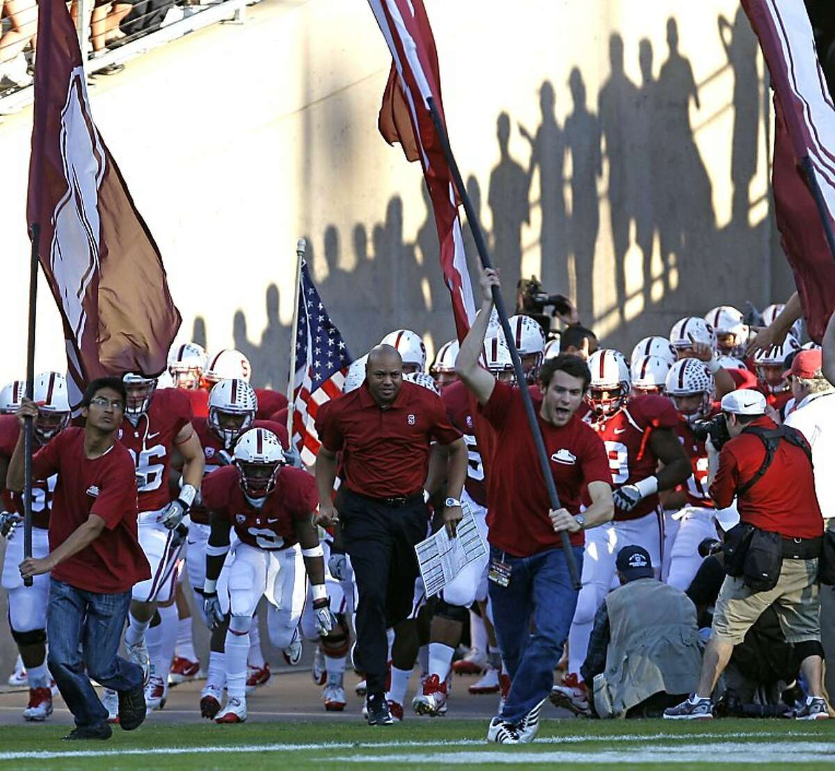 Stanford Cardinal head coach David Shaw leads his team onto the field to face the Washington Huskies at Stanford Stadium on October 22, 2011 in Stanford, California.