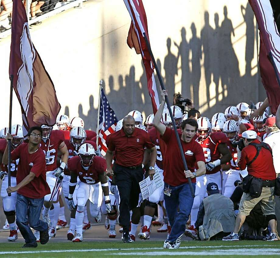 Stanford Cardinal head coach David Shaw leads his team onto the field to face the Washington Huskies at Stanford Stadium on October 22, 2011 in Stanford, California. Photo: Lance Iversen, The Chronicle