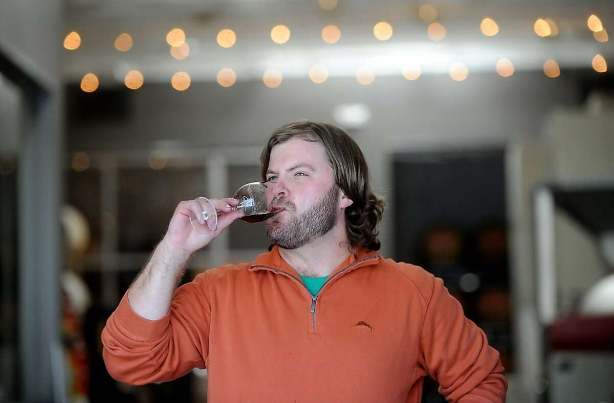 Winemaker Chris Nelson takes wine at Bluxome Street Winery on Wednesday, Oct. 19, 2011, in San Francisco