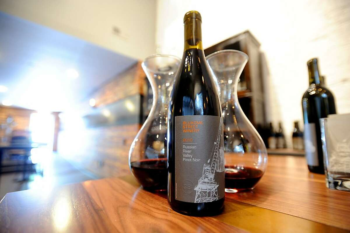 A bottle of Bluxome Street Winery's 2010 Russian River Valley Pinot Noir rests on a counter at the winery's San Francisco tasting room on Wednesday, Oct. 19, 2011.