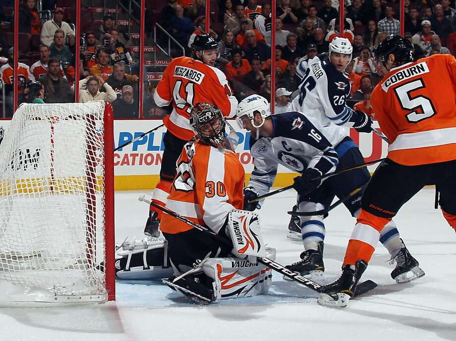 PHILADELPHIA, PA - OCTOBER 27: Andrew Ladd #16 of the Winnipeg Jets scores the game winning goal against Ilya Bryzgalov #30 of the Philadelphia Flyers at 18:54 of the third period at the Wells Fargo Center on October 27, 2011 in Philadelphia, Pennsylvania.  (Photo by Bruce Bennett/Getty Images) Photo: Bruce Bennett, Getty Images