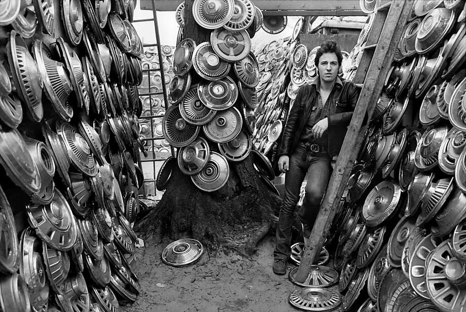 Bruce Springsteen amid the hubcaps is  one of rock photographer Lynn Goldsmith's  notable candid portraits, on view at SFAE through  Monday. Photo: © Lynn Goldsmith