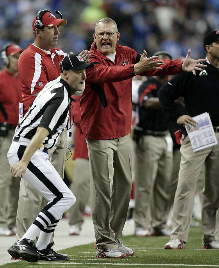 San Francisco 49ers assistant head coach Brad Seely, center, shouts at head linesman Dana McKenzie, left, after the officials conferred and ruled Detroit Lions tight end Brandon Pettigrew had scored a touchdown in the first quarter of an NFL football game on Sunday, Oct. 16, 2011, in Detroit. An official had originally ruled it was not a touchdown. (AP Photo/Duane Burleson)  Ran on: 10-28-2011 Brad Seely (center) not only leads one of the NFL's best special teams units, he's a sounding board for coach Jim Harbaugh and even has time to chew out officials. Ran on: 10-28-2011 Brad Seely (center) not only leads one of the NFL's best special teams units, he's a sounding board for coach Jim Harbaugh and even has time to chew out officials. Photo: Duane Burleson, AP