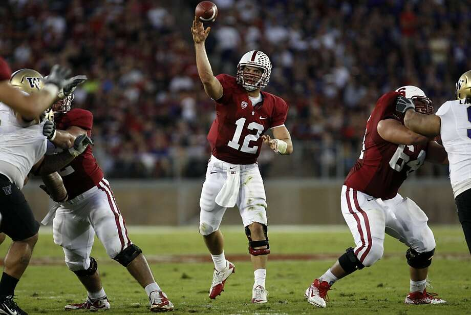 Stanford Cardinal quarterback Andrew Luck #12 throws for a first down inside the red zone during their game with the Washington Huskies at Stanford Stadium on October 22, 2011 in Stanford, California. Photo: Lance Iversen, The Chronicle