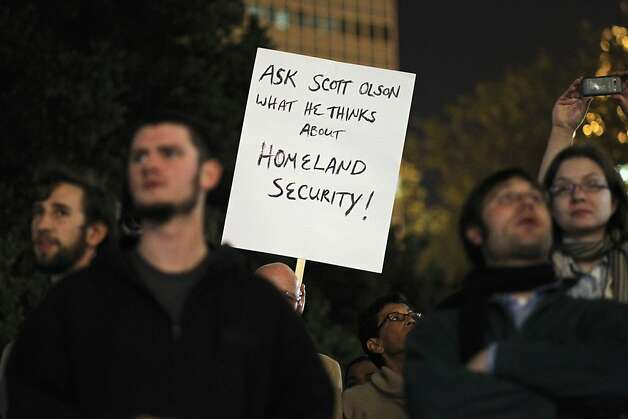 OAKLAND, CA - OCTOBER 26:  A protester holds up a sign referencing Scott Olsen, 24, a former Marine who has shot in the head by a police projectile during a protest last night, is surrounded by candles during a demonstration on October 26, 2011 in Oakland, California. Police are allowing protesters back into Frank Ogawa Plaza after the scene of violence there last night, with police firing tear gas into a crowd of hundreds of protesters associated with the Occupy Oakland movement.  (Photo by Justin Sullivan/Getty Images) Photo: Justin Sullivan, Getty Images