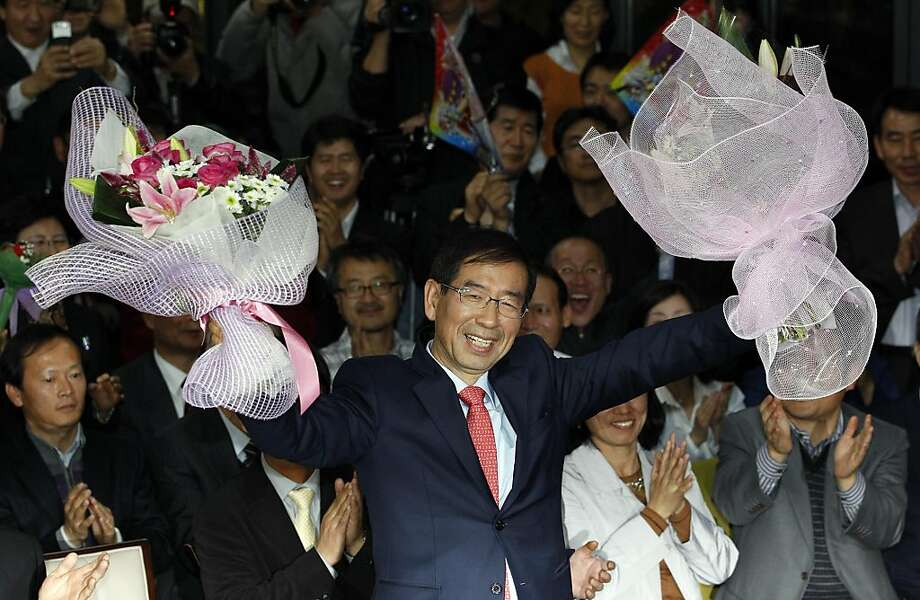 Park Won-soon, an independent candidate for mayor of Seoul, celebrates his victory at the his campaign office in Seoul, South Korea, Thursday, Oct. 27, 2011. The result is a heavy blow to Lee Myung-bak, the conservative president, who had called on the electorate not to support left wingers such as Park , who wants South Korea to forge a welfare state along European lines.  Lee has warned that such social spending could lead the country into a Greek-style fiscal crisis. (AP Photo/Lee Jin-man) Photo: Lee Jin-man, AP