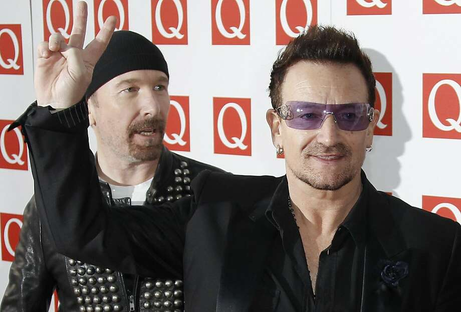 Bono, right and The Edge, of Irish band U2, arrive for the Q Music Magazine Awards at a central London hotel, Monday, Oct. 24, 2011. (AP Photo/Joel Ryan)  Ran on: 10-26-2011 U2's Bono and The Edge arrive for the Q Magazine music awards ceremony in London. Photo: Joel Ryan, AP