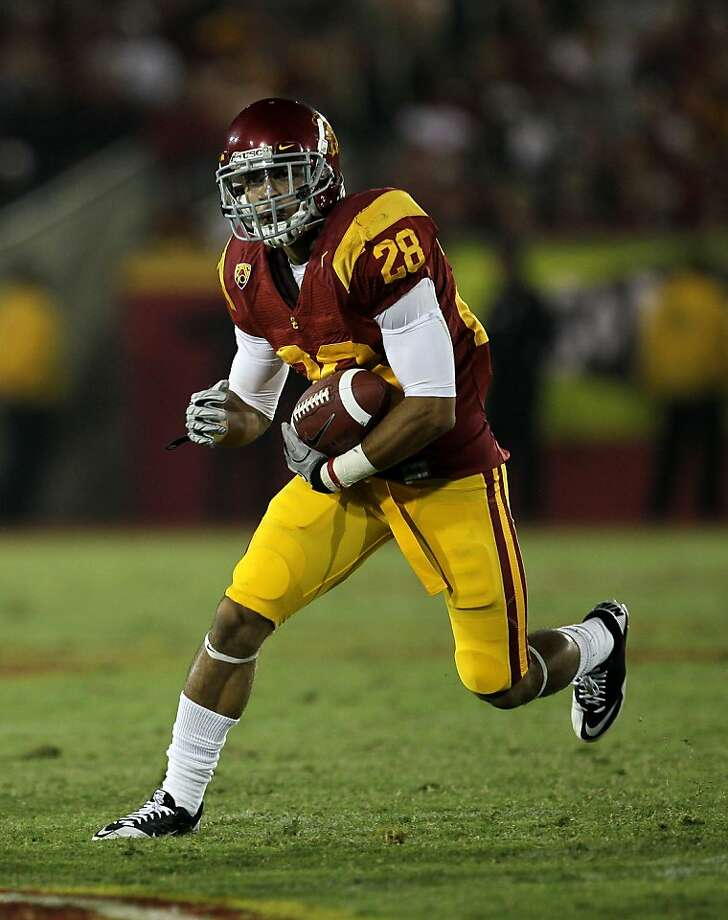 LOS ANGELES, CA - SEPTEMBER 11:  Running back Dillon Baxter #28 of the USC Trojans carries the ball against the Virginia Cavaliers at Los Angeles Memorial Coliseum on September 11, 2010 in Los Angeles, California. USC won 17-14.  (Photo by Stephen Dunn/Getty Images) Photo: Stephen Dunn, Getty Images