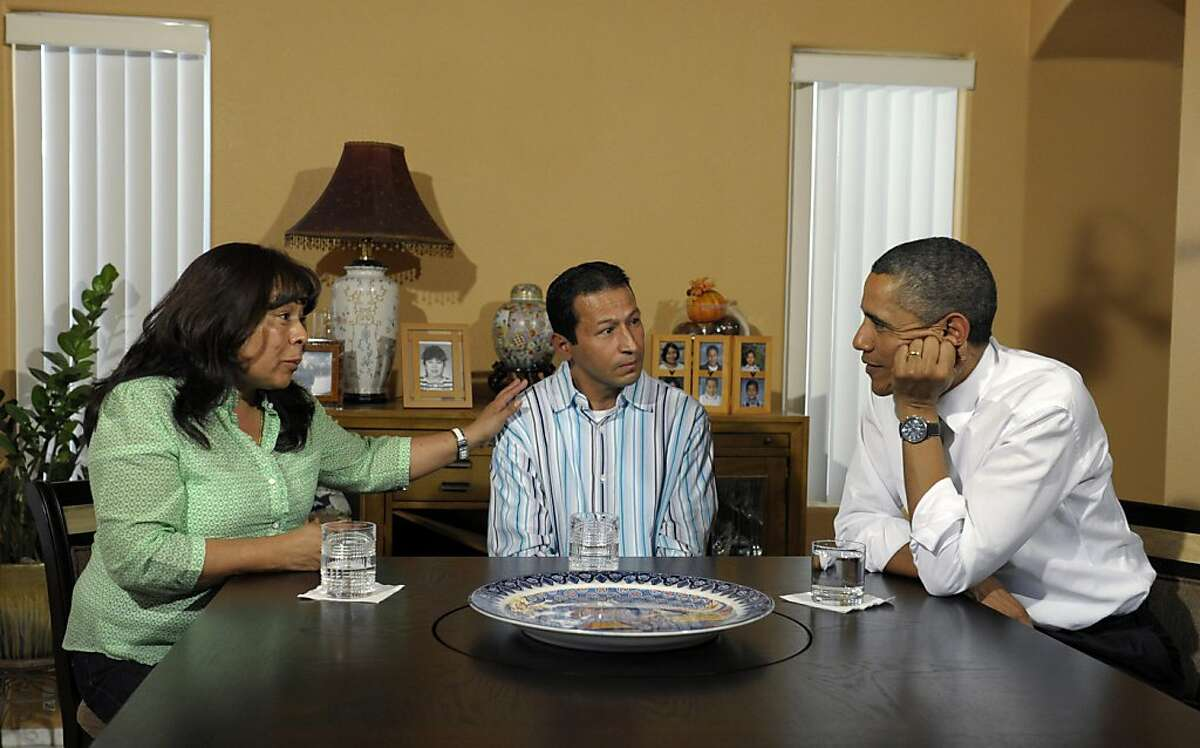 President Barack Obama talks with homeowners Jose and Lissette Bonilla in Las Vegas, Monday, Oct. 24, 2011. Obama is on a three-day trip to the West Coast. (AP Photo/Susan Walsh)