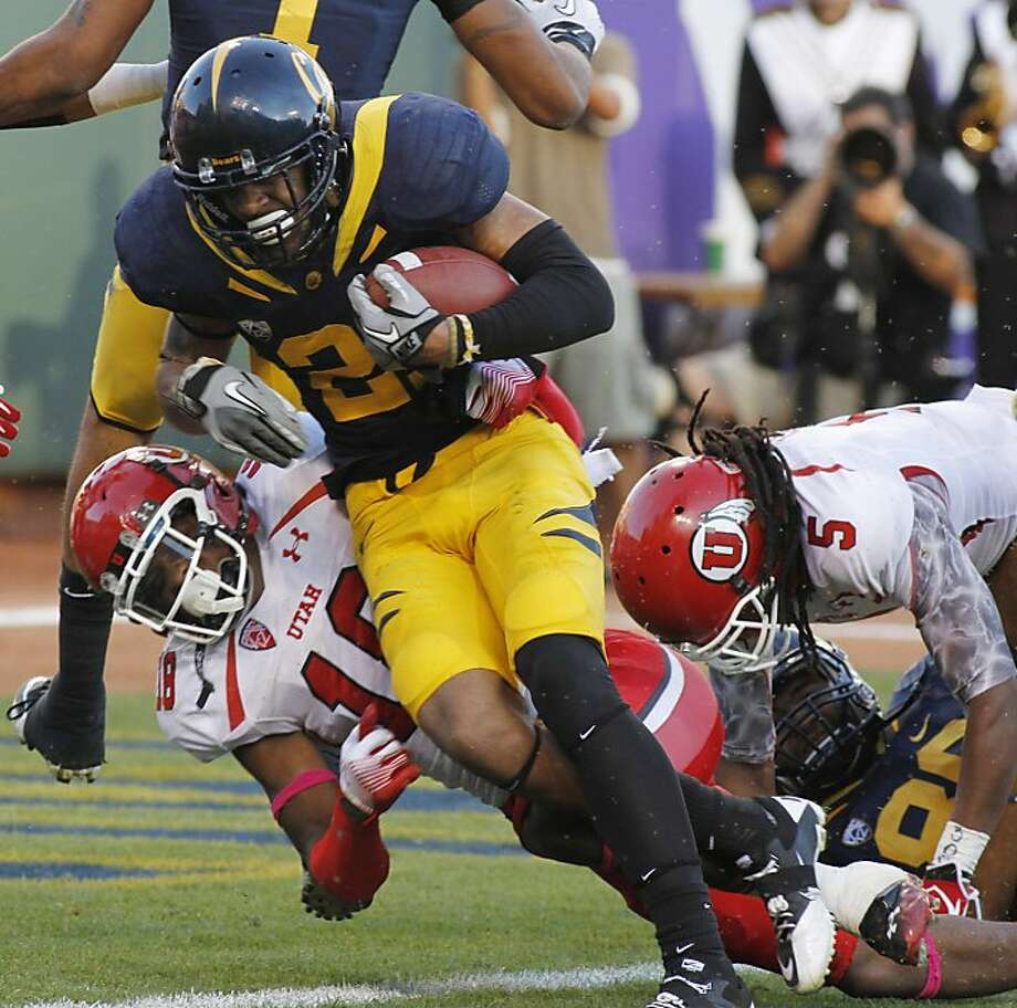 California's Keenan Allen, center, scores a touchdown past Utah's Eric Rowe, left, and Moe Lee during the first half of an NCAA college football game Saturday, Oct. 22, 2011, in San Francisco. (AP Photo/George Nikitin)  Ran on: 10-23-2011 Cal wide receiver Keenan Allen scores past Utah's Eric Rowe (left) and Moe Lee. Ran on: 10-23-2011 Cal wide receiver Keenan Allen runs for a touchdown past Utah defensive backs Eric Rowe (left) and Moe Lee. Photo: George Nikitin, AP