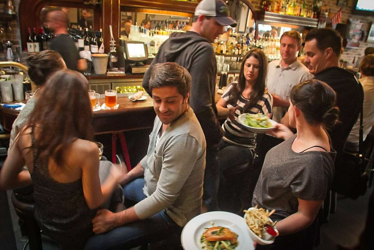 Food being served at the bar during Happy Hour at the Tipsy Pig Restaurant in San Francisco, Calif., on Friday, October 21, 2011.