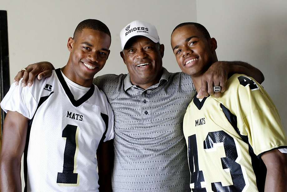 George Atkinson III, left,  and his twin brother Josh Atkinson, right, are sons of George Atkinson, Jr., center,  who was a defensive back for the Oakland Raiders in the 1970s, and now helps out coaching his sons' football team at Granada High School in Livermore, Calif. on Sunday, Sept. 7, 2008. Ran on: 09-10-2008 Ex-Raider George Atkinson (center) gave his son George III (left) his name, but Josh got his old number. Ran on: 09-10-2008 Ex-Raider George Atkinson (center) gave his son George III (left) his name, but Josh got his old number. Photo: Katy Raddatz, The Chronicle