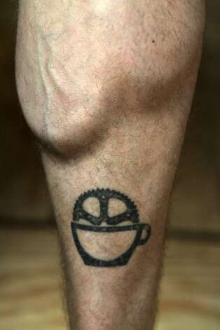 Brad Butler, a co-owner of Bicycle Coffee Co., shows a tattoo of the company's logo on his leg on Thursday, Oct. 20, 2011, in San Francisco, Calif. Photo: Mathew Sumner, Special To The Chronicle