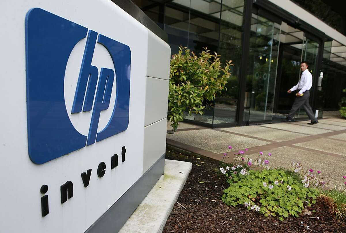 A worker arrives at Hewlett Packard Company headquarters in Palo Alto, Calif., Monday, June 1, 2010. HP said it will lay off about 9,000 workers in the unit that provides technology services to other businesses as the company consolidates and automates its commercial data centers. The cuts will be made over about three years and amount to some 3 percent of HP's global work force. (AP Photo/Paul Sakuma) Ran on: 06-02-2010 A worker arrives at Hewlett-Packard in Palo Alto on the day the company said it would restructure its computer services. Ran on: 09-30-2010 Hewlett-Packard's forecast topped expectations.
