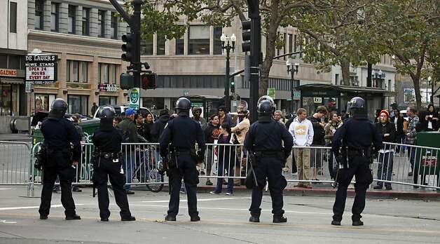 Oakland police officers stand guard in front of Frank H. Ogawa plaza after they evicted Occupy Oakland protestors Tuesday, Oct. 25, 2011, in Oakland, Calif. Photo: Lance Iversen, The Chronicle