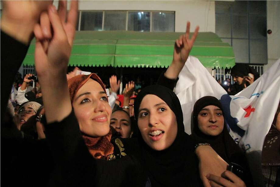 Tunisian supporters of the moderate Islamic party Ennahda celebrate as they claim victory at the party's headquarters in Tunis, Tuesday, Oct. 25, 2011. Partial results released supported the Ennahda party's claims that it had won the most seats in a 217-member assembly tasked with running the country and writing its new constitution. But results so far indicate the Islamists had failed to win an outright majority, meaning a coalition must be formed. (AP Photo / Amine Landoulsi) Ran on: 10-26-2011 Backers of the moderate Islamic party Ennahda celebrate as they claim victory at party headquarters in Tunis, Tunisia. Ran on: 10-26-2011 Backers of the moderate Islamic party Ennahda celebrate as they claim victory at party headquarters in Tunis, Tunisia. Photo: Amine Landoulsi, AP